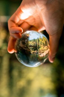 Free Person Holding Clear Glass Ball Royalty Free Stock Photography - 126185137