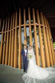 Free Photography Of Couple Stands In Front Wooden Wall Stock Image - 126185151