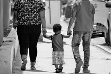 Free Grayscale Portrait Of Man, Woman, And Child Holding Hands Royalty Free Stock Images - 126185579