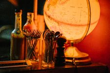 Free Lighted Desk Globe Beside Condiment Shaker And Flatware Set Stock Photos - 126185723