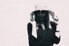Free Woman Wearing Black Long-sleeved Shirt Holding Straw Hat Royalty Free Stock Photos - 126185728