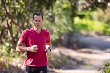 Free Man Running On Path Surrounded With Trees Royalty Free Stock Photos - 126185878