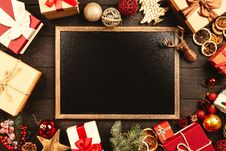 Free Chalkboard Surrounded By Christmas Gifts Stock Photography - 126185972