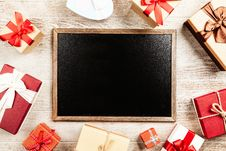 Free Chalkboard With Brown Wooden Frame Surrounded By Red Gift Boxes Stock Image - 126186351