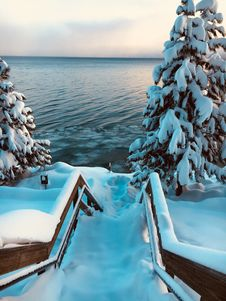 Free Snow Covered Stairs Near Body Of Water Royalty Free Stock Photos - 126186388