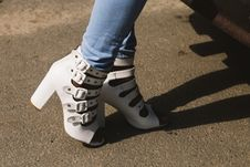 Free Person Showing Pair Of White Peep-toe Chunky Heel Sandals Royalty Free Stock Image - 126186456