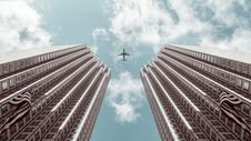 Free Worm S-eye View Photo Of Plane Between Two High-rise Buildings Stock Photo - 126186660
