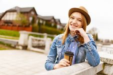 Free Woman Holding Cup Of Tea Leaning On Fence Royalty Free Stock Images - 126187229