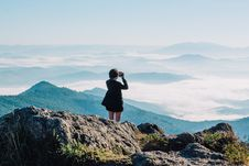 Free Woman Taking A Picture Of Mountains Stock Images - 126187664