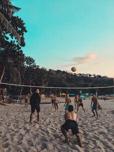 Free Group Of People Playing Beach Volleyball On Shore Stock Images - 126187854