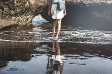 Free Woman Walking On Seashore Stock Photo - 126187960