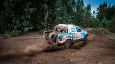 Free White And Blue Pickup Truck Drifting On Curve Dirt Road Royalty Free Stock Images - 126188199