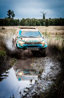 Free Blue Toyota Car On Dirt Road Stock Photography - 126188202