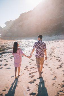 Free Couple Holding Hands Walking On Seashore Stock Photo - 126188340