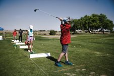 Free Person Swinging Golf Club On Field Stock Images - 126188404