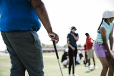 Free Person Holding Golf Club Near Girl And Woman Royalty Free Stock Images - 126188459