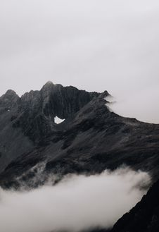 Free Rock Mountain Covered With Fog Stock Photo - 126188500