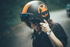 Free Woman Wearing Black Shirt And Black-and-orange Half-face Helmet Royalty Free Stock Photo - 126188505