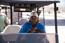 Free Man Sitting On Golf Cart Royalty Free Stock Photos - 126188568