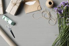 Free High-angle Photo Of Purple Flowers, Brown Yarn And Brown Envelopeon Gray Table Royalty Free Stock Image - 126188606