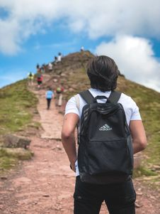 Free Man Carrying Black Addidas Backpack Royalty Free Stock Images - 126188609