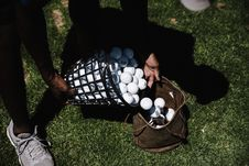 Free Person Pouring Golf Balls In Brown Leather Bag Stock Images - 126188694