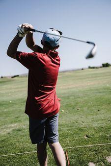 Free Man Swinging Golf Club Facing Grass Field Royalty Free Stock Image - 126188696