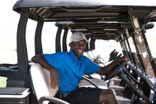 Free Man Sitting On Black And Gray Golf Cart Royalty Free Stock Photography - 126188747