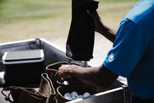 Free Man Pouring Golf Balls In Leather Bags Stock Image - 126188881
