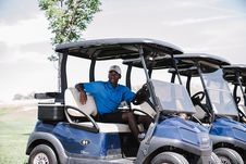 Free Man Riding On Golf Cart Stock Images - 126188894