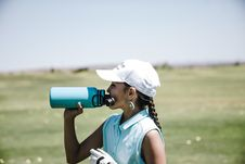 Free Woman Drinking At Blue Sports Bottle Outdoors Royalty Free Stock Images - 126188919