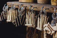 Free Brown Wind Instruments Hanging On Hooks Stock Photo - 126189150