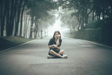 Free Girl Sitting On Gray Concrete Road Stock Image - 126189151