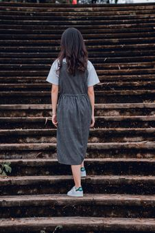 Free Woman Standing On Gray Concrete Stairs Stock Image - 126189421