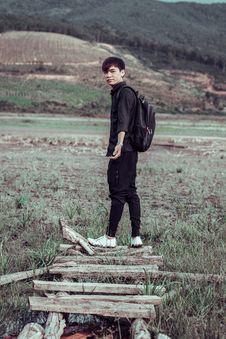 Free Man Wearing Black Jogger Pants And Backpack Stock Image - 126189441