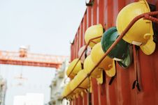 Free Yellow And Green Hard Hat On Rack Stock Photos - 126189443
