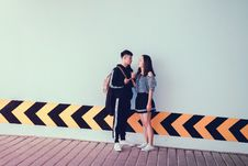 Free Man And Woman Looking At Each Other Near Wall Stock Photo - 126189490