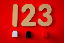 Free 123 Cutout Decor On Red Surface Royalty Free Stock Photo - 126189615