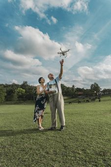 Free Man Standing Beside Woman Playing Drone Royalty Free Stock Photography - 126189727