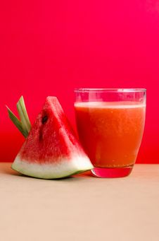 Free Watermelon Shake Filled Glass Cup Beside Sliced Watermelon Fruit On Brown Surface Royalty Free Stock Photo - 126189745