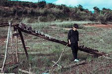 Free Man Leaning On Wooden Bridge On Grass Field Royalty Free Stock Photos - 126189818