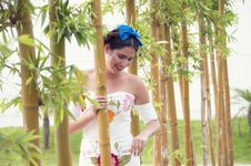 Free Woman Behind Bamboo Grass Stock Photography - 126189972