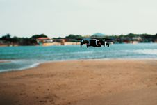 Free Black Quadcopter Drone On Flight Stock Image - 126189991