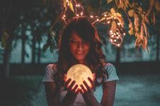 Free Woman Holding Moon Lamp Stock Photography - 126190112