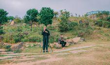 Free Man In Black Top Taking Photo Outdoors Stock Image - 126190141