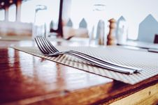 Free Two Stainless Steel Forks On Top Of Place Mat Stock Photography - 126190282