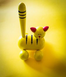 Free Yellow And Red Cat Figurine On Yellow Top Stock Images - 126190304