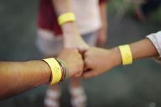 Free Three Yellow Admission Bracelets Royalty Free Stock Image - 126190456