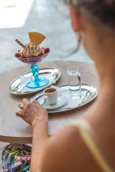 Free Woman Sitting On Chair While Her Left Hand Beside Coffee Mug On Gray Tray Stock Images - 126190534