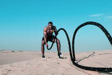 Free Man Holding Exercise Rope Stock Image - 126190541